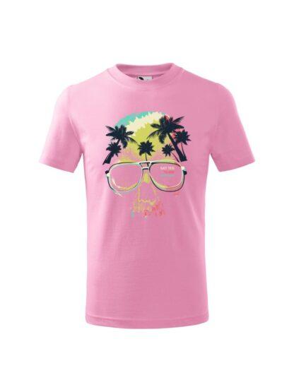 Dziecięca koszulka z krótkim rękawem i kolorowym motywem czaszki oraz napisem Say Yes To New Adventures. Koszulka różowa.