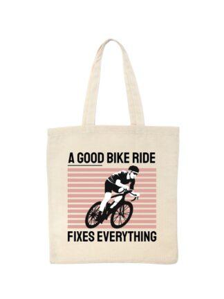 Ekotorba bawełniana w kolorze ecru z kolorowym nadrukiem kolarza szosowego oraz napis A Good Bike Ride Fixes Everything.