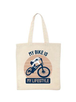 Ekotorba bawełniana w kolorze ecru z kolorowym nadrukiem kolarza MTB oraz napisem My Bike Is My Lifestyle.