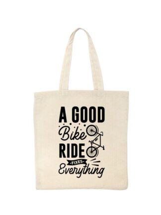 Ekotorba bawełniana w kolorze ecru z czarnym, stylizowanym napisem A Good Bike Ride Fixes Everything.